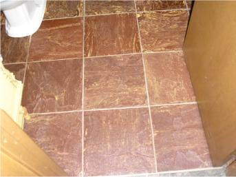 Attractive Molded Rubber Flooring Tiles with Acrylic Grout Provide Cushion and Comfort!