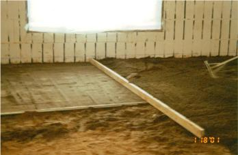 After Backfil and Plumbing Installation, the Interior Soil is Levelled in Preparation for the Moisture Barrier and Foam